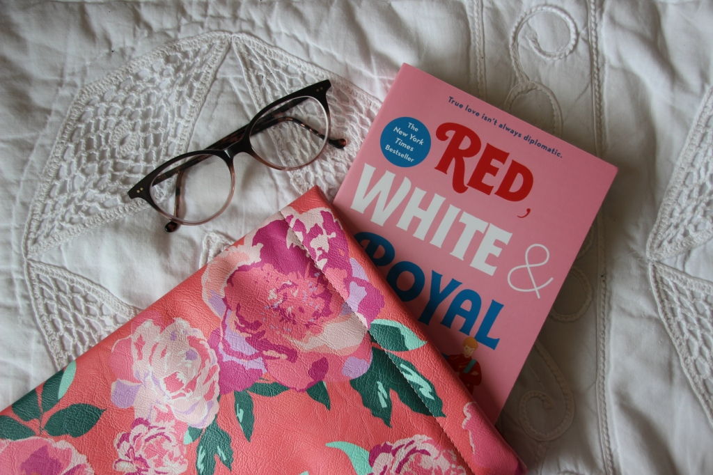 Photo of Red, White, and Royal Blue and book sleeve from Indigo