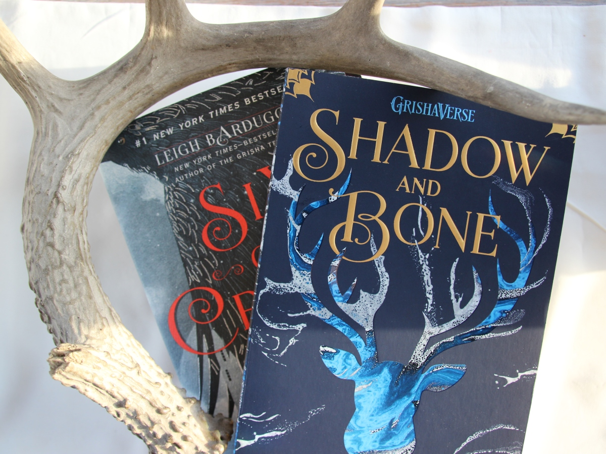 Shadow and Bone and Six of Crows book surrounded by antler